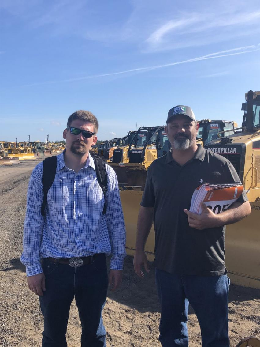 Shopping for crawlers are Jay Brooks (L) of Heavy Yellow Equipment, Marietta. Ga., and Tim Thompson of Thompson Grading and Clearing, Carlton, Ga.