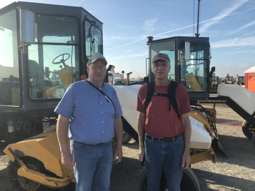 Mark (L) and Rick Charbonneau of Continental Paving Inc.,  Londonberry, N.H., were inspecting some Broce brooms.