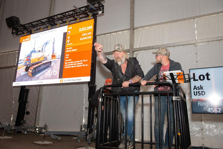 Gold Rush TV stars Tony and Kevin Beets were on site at Ritchie Bros. Orlando auction and caught bids from the crowd for the special edition Volvo excavator. (CNW Group/Ritchie Bros. photo)