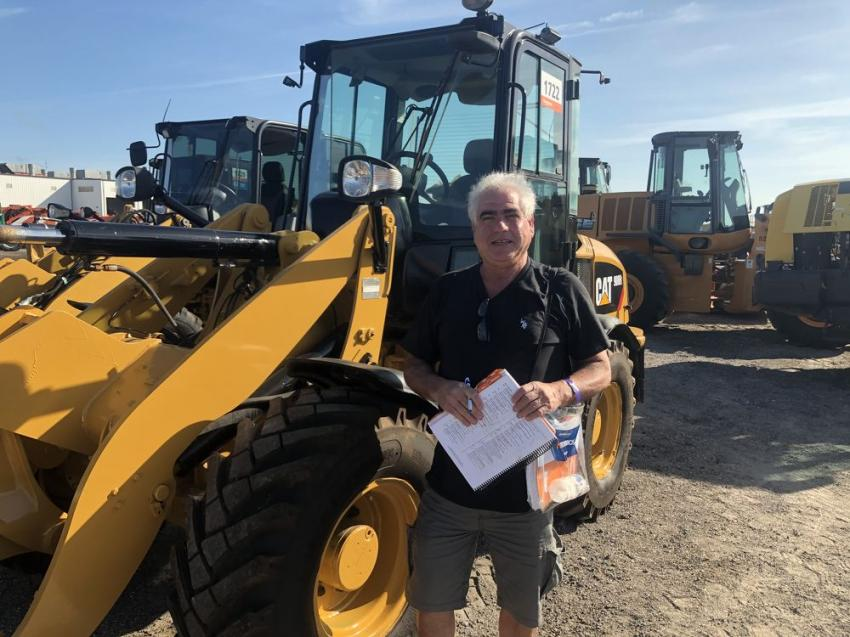 Mike Zyndorf, owner of Mike Zyndorf Equipment LLC, Mays Landing, N.J., checks out a Cat wheel loader.