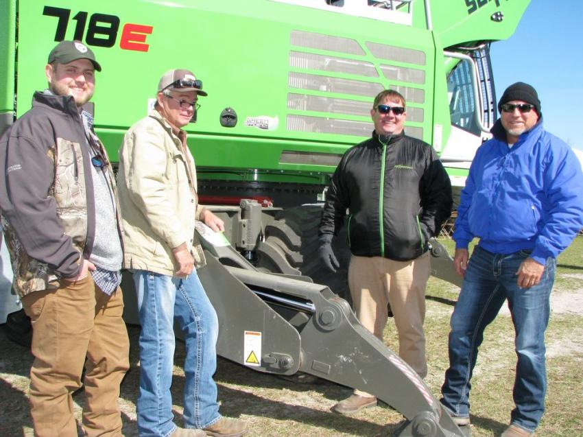 (L-R): Fellow Sennebogen dealer Tractor & Equipment Company's Tanner Rhea with Ladd Tharpe of Florida Right of Way Corporation, Marianna, Fla.; Ryan Zenor of Sennebogen; and David Williams, GSE-Tallahassee, Fla., do a comprehensive walk-around of the demo machine.