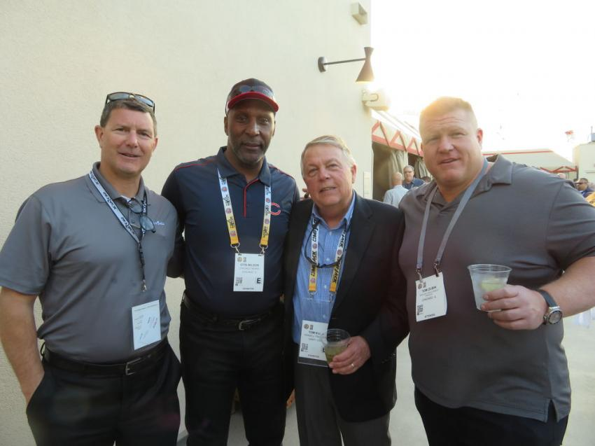 Several members of the 1985 Chicago Bears Super Bowl Championship team were on hand at the party, including Pro Bowler Otis Wilson (second from L). With Wilson are (L-R) Joel Robinson, managing director of credit and leasing of Skyjack; Tom Ellis, retired president of Howell Tractor; and Tom Zubik of Midland Equipment Finance.