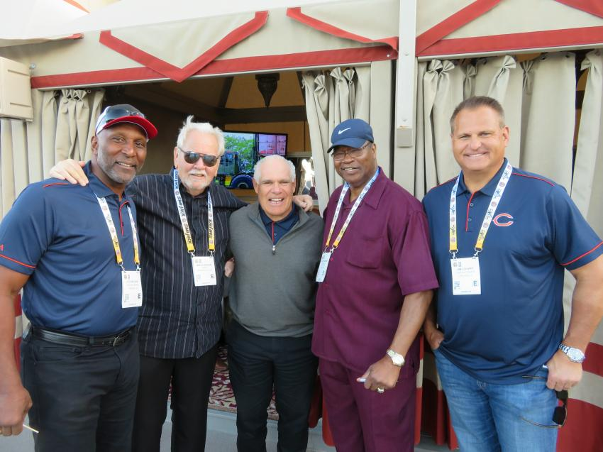 Mike Lanigan (second from L), president of the Lanco Group of Companies, welcomes (L-R) Pro Bowler Otis Wilson, 1985 Chicago Bears Super Bowl Championship team; Matt Suhey, also of the 1985 Bears; Larry Holmes, Heavyweight Boxing Champion; and Pro Bowler Jimbo Covert, also of the 1985 Bears.