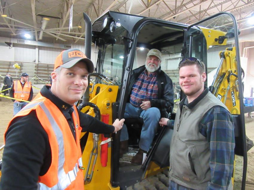 (L-R): Jesse Wotruba, Company Wrench JCB territory sales manager, gives details to Richard Teisinger of R.W. Teisinger Excavating and son, Chuck, on this 1CXT backhoe loader.