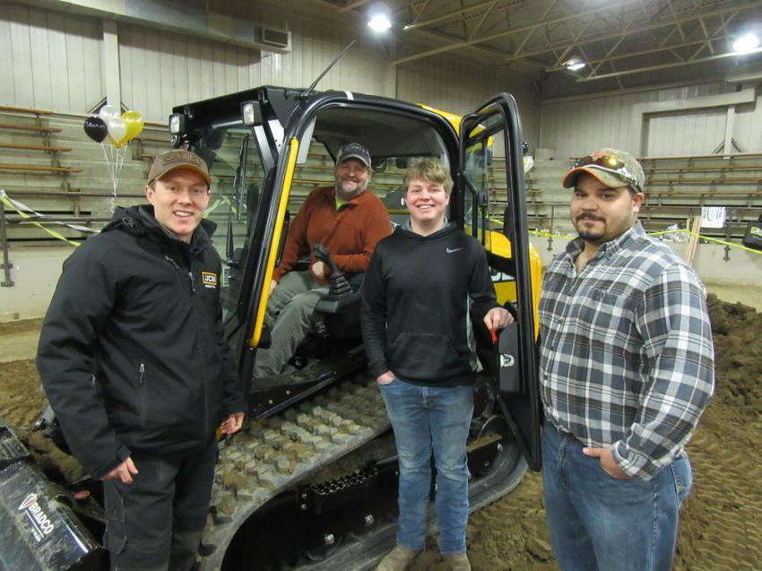(L-R): Will Turner, JCB regional business manager, reviews equipment with Cooper Concrete's Jason and son, Tyler Cooper, and Marcus Bird.