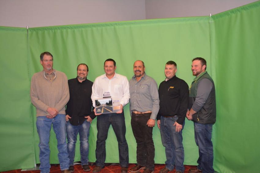 Schmidt Construction Company won in the City Street category for its work in the Town of Castle Rock. (L-R): Zane Ferrin and Tom Klasing of Schmidt Construction, Town of Castle Rock's John Weber along with Antolino Delatorre, Jeff Lawson and Brandon Beck, also of Schmidt Construction.