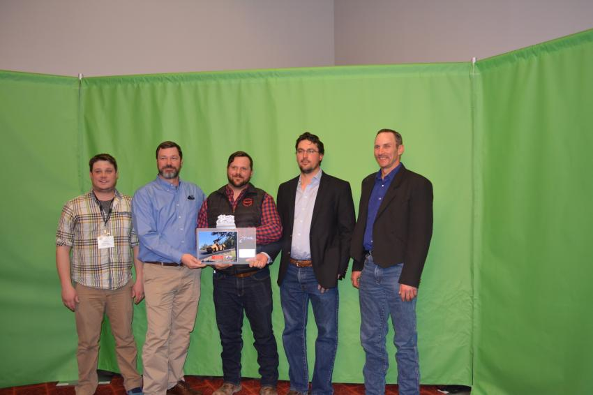 Coulson Excavating Company won the award in the City Street Resurfacing category for its work in Larimer County. (L-R): Larimer County's Chris Braeger and Eric Purcell along with JD Kleim, Matt Coulson and Terry Reusnic of Coulson Excavating.