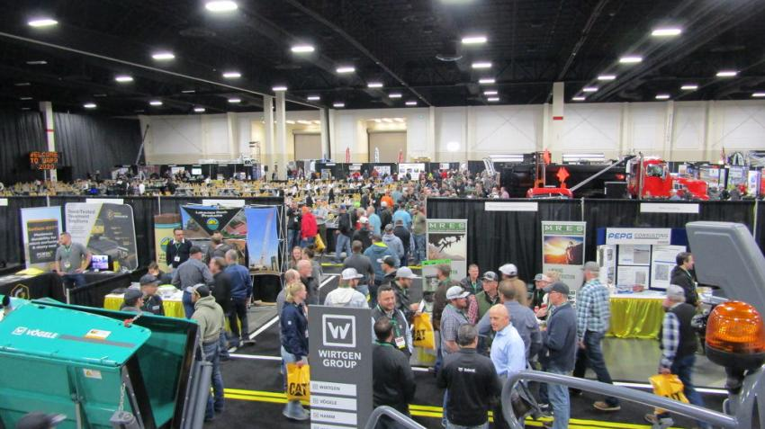 Attendees visit exhibitor displays between seminars.