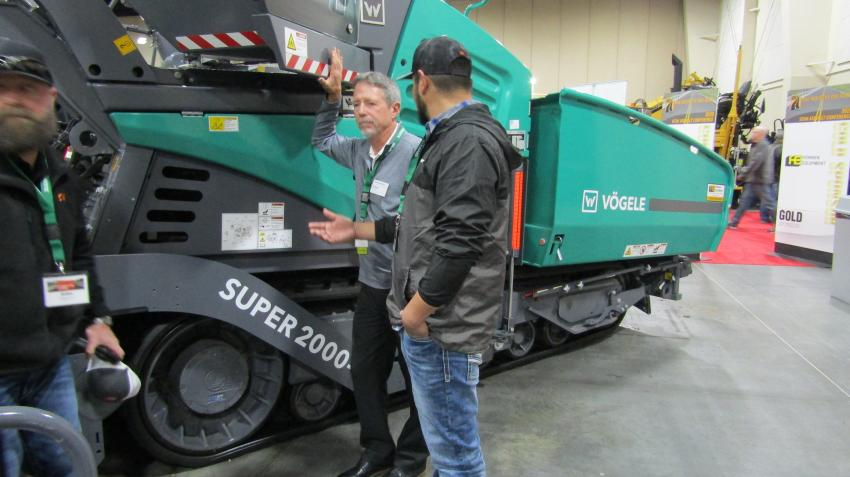 Representing Honnen Equipment, Steve Daigh of Wirtgen America discusses the versatility of the new Vögele's Super 2000-3i asphalt paver with Luis Martinez of Knife River.