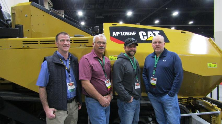 (L-R): Todd Mansell, Cat Paving, Aaron Venz of Wheeler Machinery, customer Troy Riley of Green Construction and Cody Rhoades of Wheeler Machinery display the Cat AP1055F paver. The Cat AP1055F is known for its high travel speed, flotation, traction and mobility.
