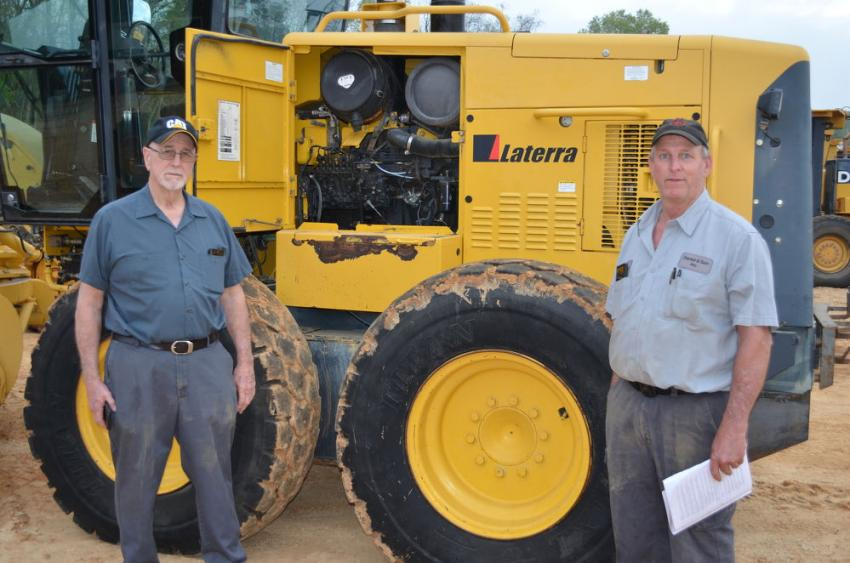 Looking for machines for their logging operations are Hunky Daniel Sr. (L) and Hunky Daniel Jr. of Daniel & Son Inc., Union Springs, Ala.