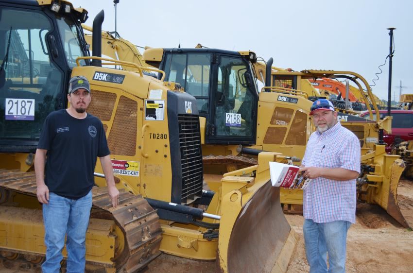 Inspecting some dozers of interest are Mike Cates (L) and Chris Cates of Wayne Cates Logging, Bremen, Ala.