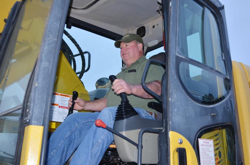 Tom Dotson of Dotson & Gibbs, New London, Mo., puts a Komatsu PC220 excavator through a complete operational inspection.
