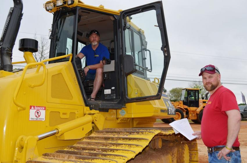 Inspecting a Komatsu D61PX dozer are Roger Wenning (in cab) and Nick Wenning of Wenning Excavating & Draining Inc., Greensburg, Ind.