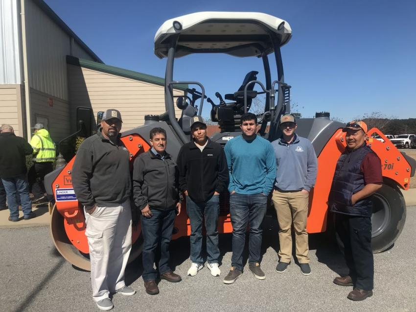 The guys from Tripp Brothers Construction in Ayden, N.C., checked out this Hamm compactor while enjoying some downtime during Linder's seminar.