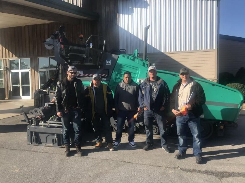 """Employees of Johnson Brothers in Lillington, N.C., took a look at this Vogele SUPER 1700-3i road paver on display at """"The Farm"""" in Selma, N.C."""