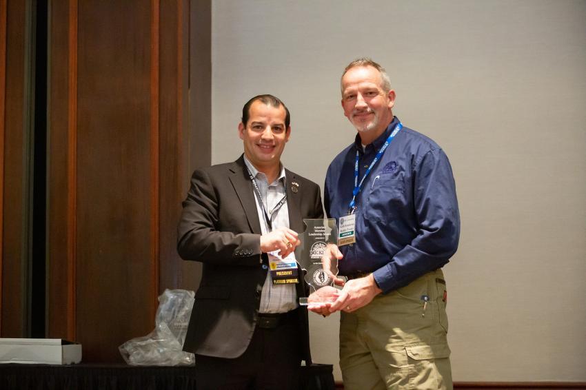 Keith Henderson (R) accepts the award from Aaron Ozinga.