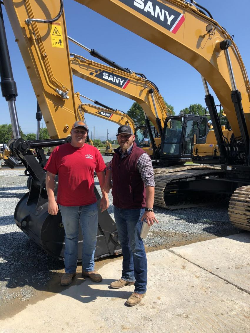 Lauson Purser (L) of L.B. Purser Grading in Midland, N.C., and Russell Griffin of Ironpeddlers go over the SANY excavators.