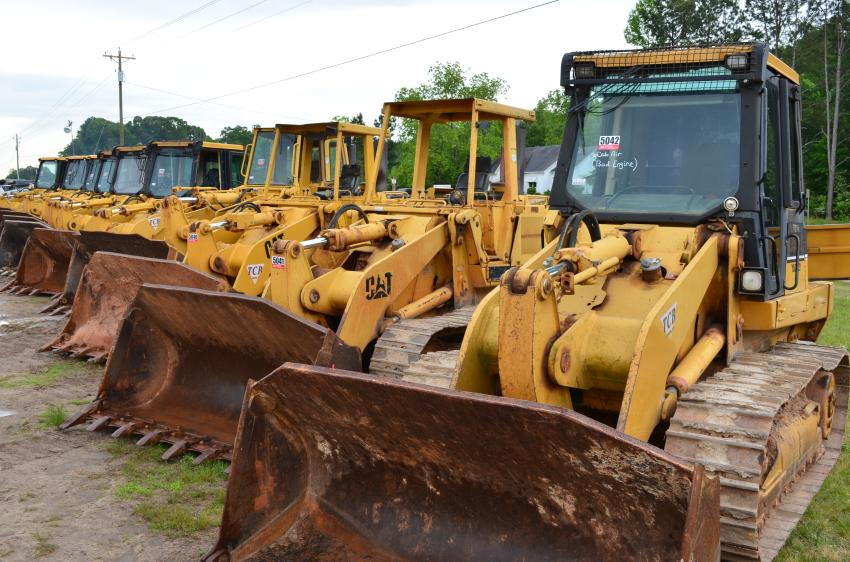 Ten Cat track loaders went on the auction block and were quickly snagged for site development work.