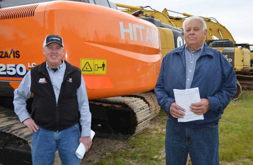 Looking over some excavators of common interest are Bert Sellers (L) of Sellers Bros. Inc., Danville, Va., and Rick Sowers of Sowers Construction, Mt. Airy, N.C.