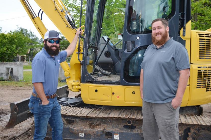 Mutually interested in this Komatsu PC88 MR are Alex Myers (L) of Myers Heavy Equipment, Lexington, N.C., and Sam Maier of Four D Equipment, Savannah, Ga.