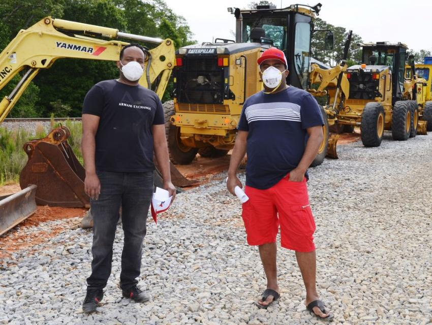 These gentlemen strapped on their face masks before checking out a couple of D5's in the sale lineup.