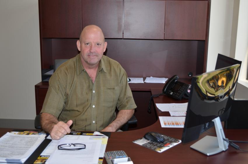 Company president Chuck Spooner is settled into his new office at the new location.