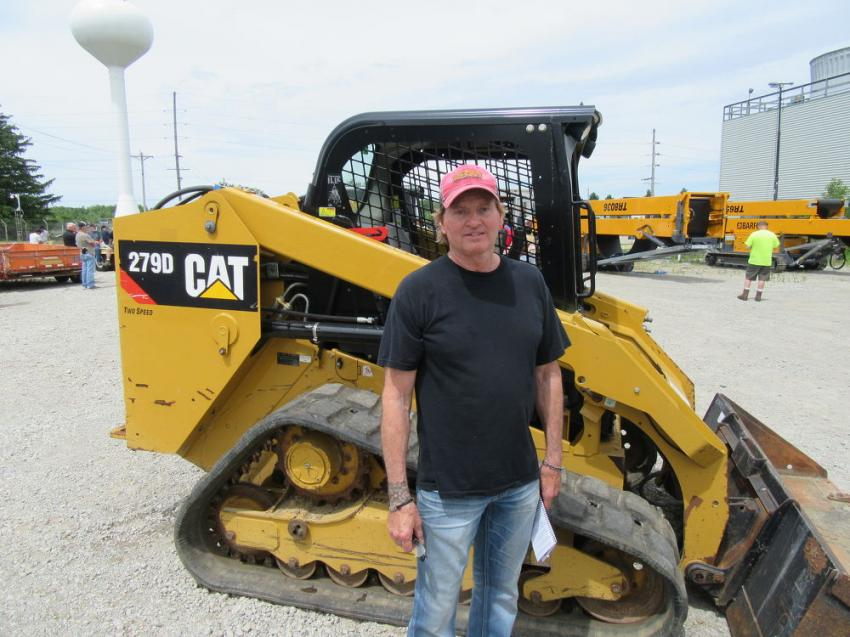 Mike Flowers of Tri-State Equipment Company was pleased to have placed the winning bid on this Cat 279D skid steer loader at the Findlay sale.