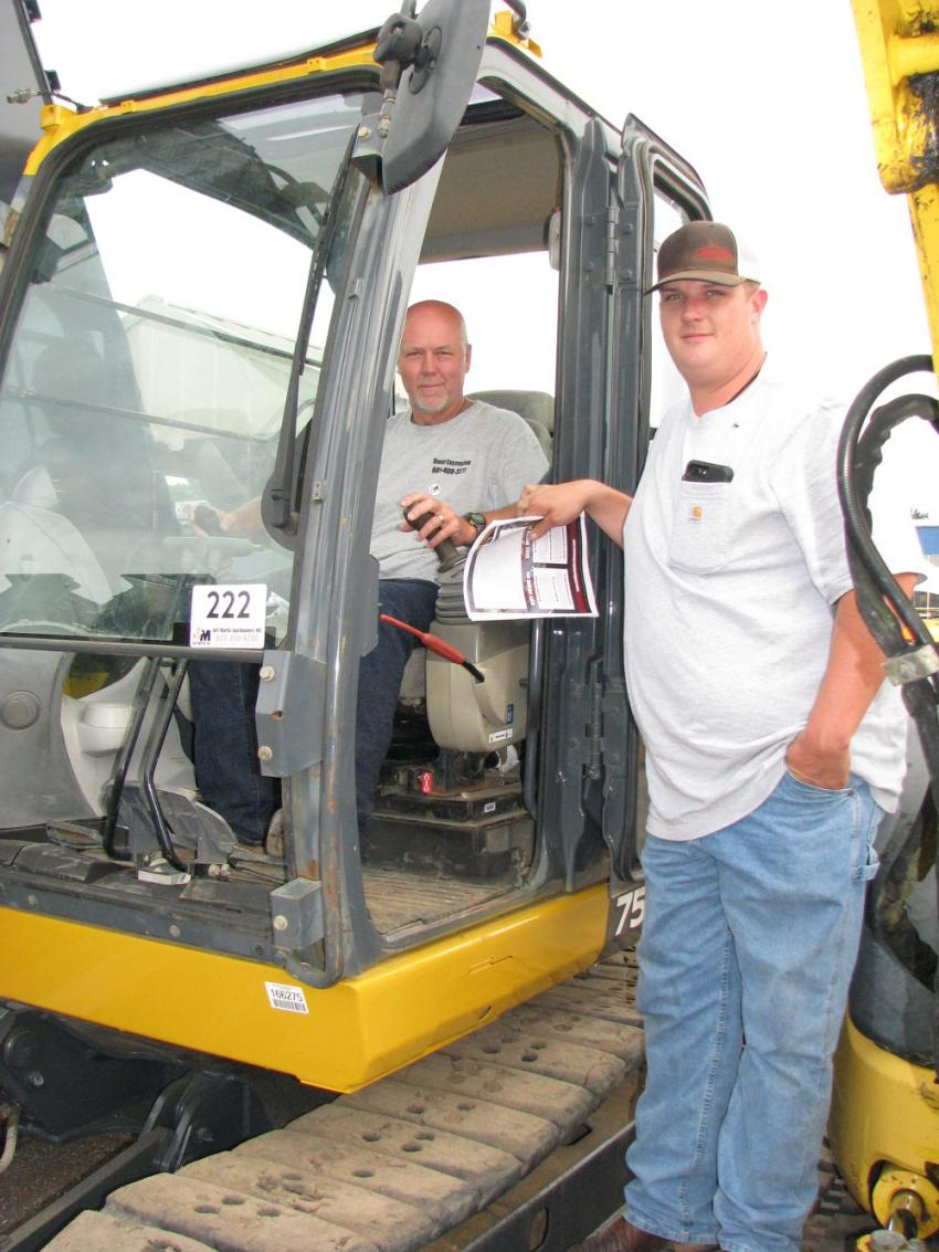 Mitchell Bond (L) and Wil Ezell of Bond Excavating, Hattiesburg, Miss., take a look at some mini-excavators of interest, including this John Deere 75G.