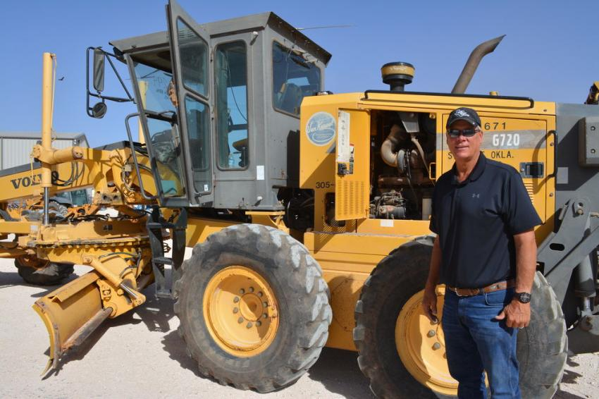 Doyle Weishuhn of Midwest Truck Center inspects a Volvo 6720 motor grader that he would later bid on.  Weishuhn's company provides equipment and services to the Texas-New Mexico oil field.
