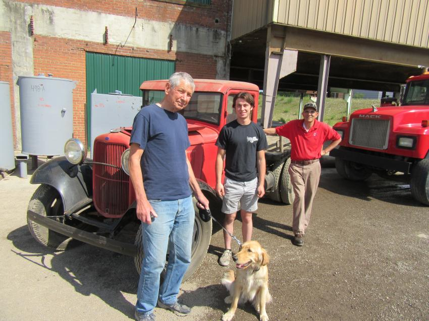 (L-R): Tom Perko, Anthony Frato and Bob Tripodi of Collinwood Iron and Metal Recycling and Salvage look over this 1932 Ford Model B flatbed truck up for bid at the auction.