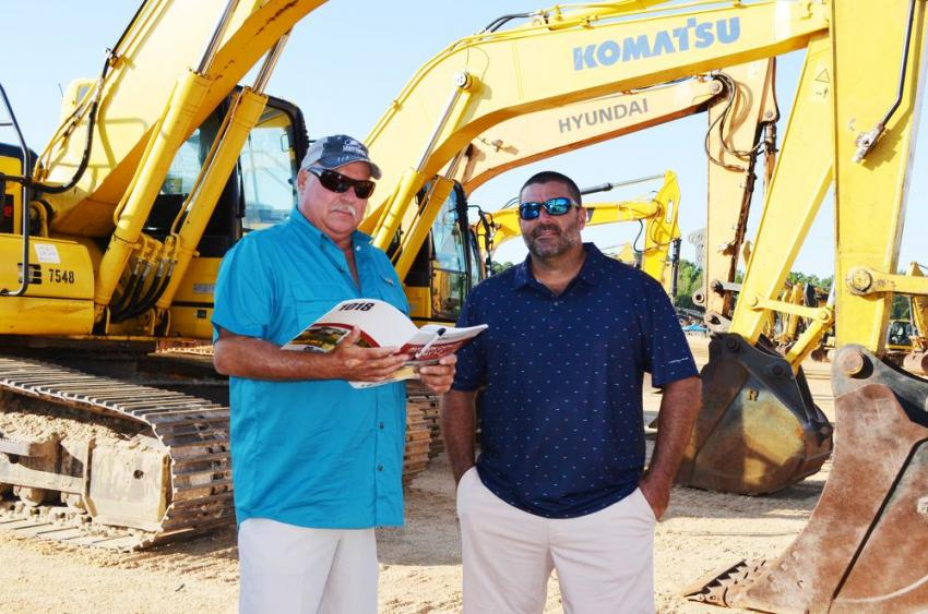 Looking over some catalog info on excavators are Ricky Melancon (L) and Paul Chevalon of Pro-Test, based in Lafayette, La.