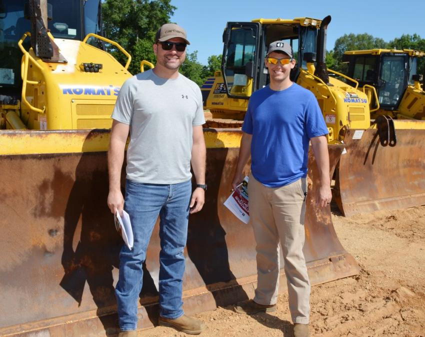 Getting ready to take a seat in the theatre area to bid on some Komatsu dozers of choice are Dallas Townsel (L) and Garrett McDonald of D&X Hauling, Gadsden, Ala.