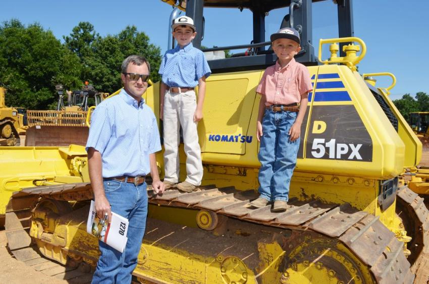 School's out for the summer and the boys join dad for some auctioning. (L-R): Cliff Harris and his sons Trace and Rhett, of CH Harris, Inc., Cullman, Ala.