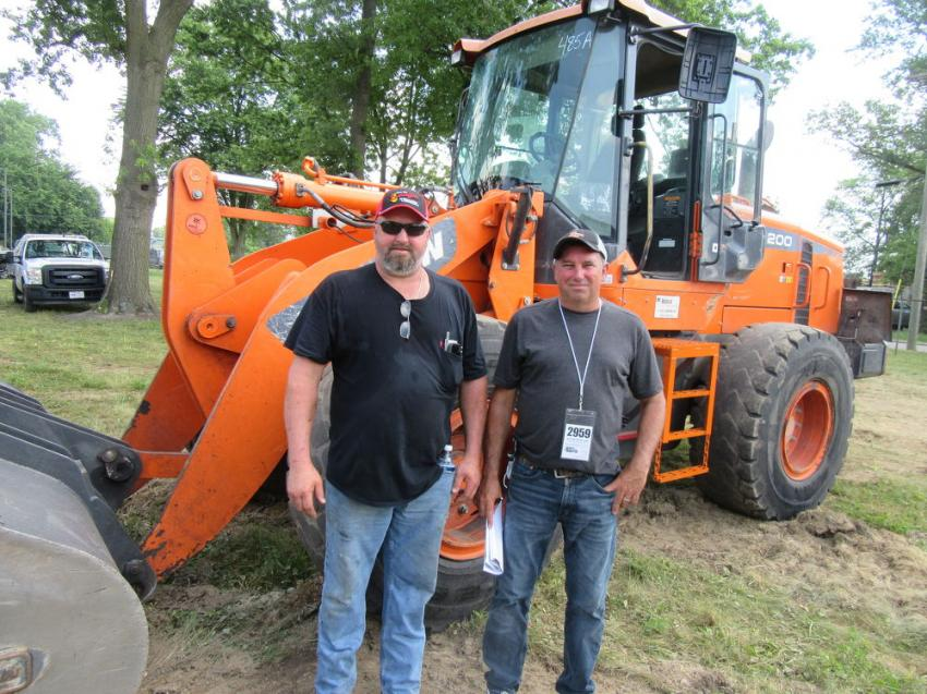 George Tatman (L) and Frank Vlack of Allied Development Group Inc. had their eye on several items, including this Doosan wheel loader.