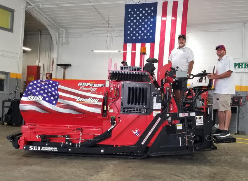 """Joe Hoffer (L) and Joey Hoffer take delivery of the first ever, eye catching """"Stars & Stripes"""" themed LeeBoy 8520B paver from Stephenson Equipment."""