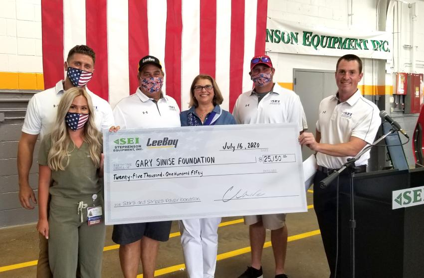 (L-R): Scott Schatz, SEI's territory manager and his wife Alyssa Schatz, physician asst. of UPMC Pinnacle Health; Joe, Linda and Joey Hoffer, all of Hoffer Paving, Annville, Pa.; and Charlie Walsh, EVP of sales and marketing of Stephenson Equipment, holding the donation check to the Gary Sinise Foundation presented at the event.