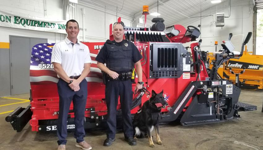 Charlie Walsh (L), EVP of sales and marketing of Stephenson Equipment, took time to pose for a photo with Mechanicsburg Police Officer Justin Shutt and his K9 partner Marc at the event. There were a group of first responders on hand to commemorate the delivery and donation made.
