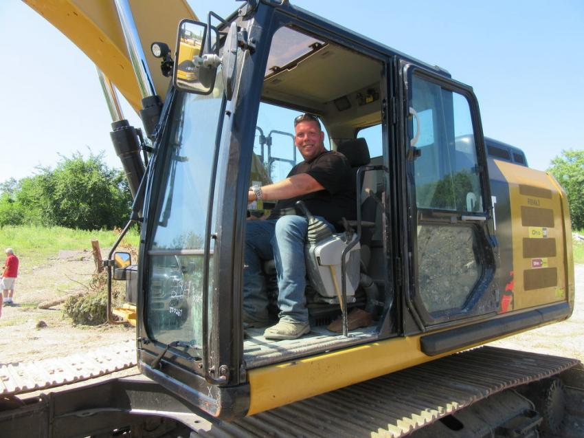 Dale Collins of Snow & Ice Solutions tries out a Cat 320E L excavator.