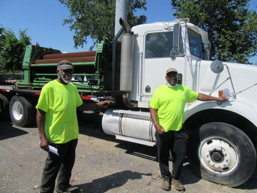 Jeff Kelly (L) and Stan Houston of Houston's Towing reviewed the trucks up for bid at the auction.