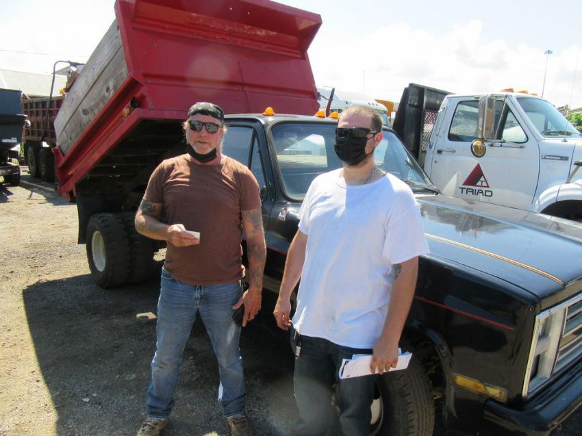 Father-and-son team Jeff Cole senior and junior, of Jeff Cole Contractors, came to the auction in search of a dump truck.