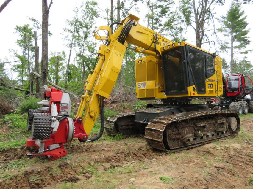 The Komatsu XT430 demonstrates what it can do with a Log Max 7000 XT harvester head attachment.