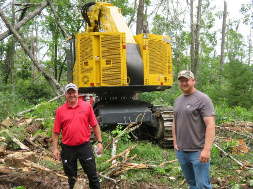 Marcus Steigerwaldt (L), of Komatsu's forest division, and Mark Strong, of Strong Logging, watched the Komatsu 430-5 track harvester work.