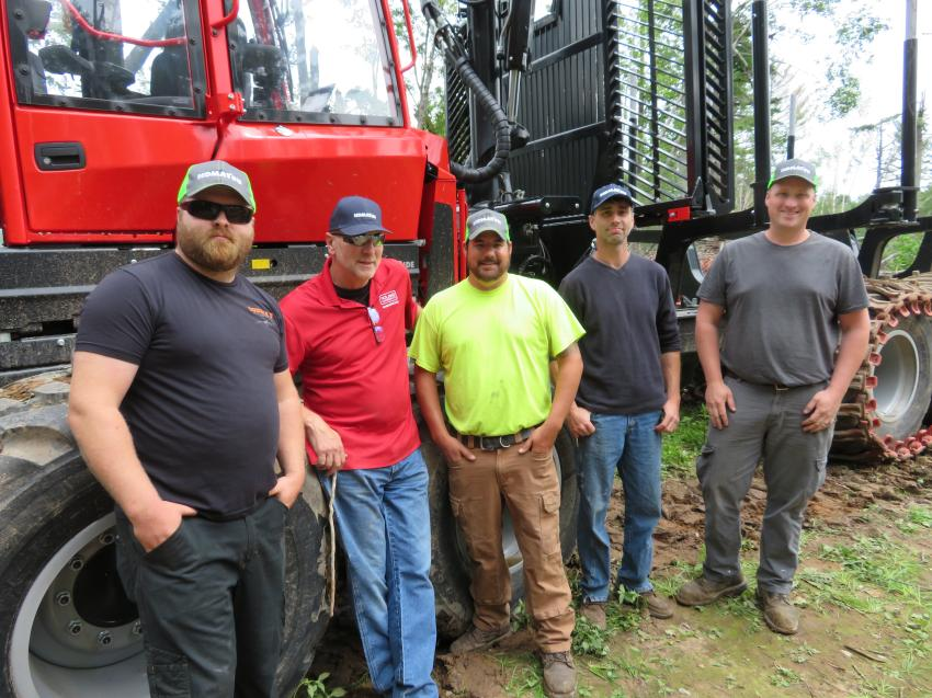 (L-R): Justin Nacius of CTL Timber Harvesting and Reel Tree Contracting; Larry Jarecki of Roland Machinery Co.; Kevin Houle of Ted Houle and Sons; Jesse Christiansen of Parkview Forestry; and Zach Dalbec of Parkview Forestry, with the Komatsu 855 forwarder.