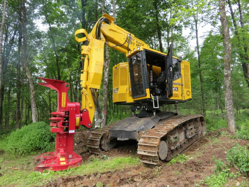 The Komatsu XT445-5L tracked feller buncher is equipped with the QUADCO continuous saw.