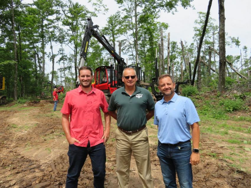 (L-R) Justin Horack and Mark Karow, both of Interstate Tree Land Clearing, talk with Roland Machinery Co.'s Aaron Strade.