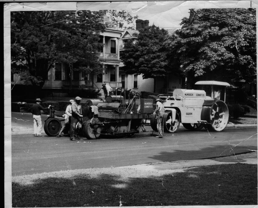 An Adnun Black Topper asphalt paver and Galion three-wheel roller at work on the streets of Cincinnati, Ohio, for Murdock Construction Company in the early 1950s. Along with Barber-Greene, Adnun Engineering & Manufacturing Company developed the first self-propelled, free-traveling asphalt pavers; however, their designs differed significantly.