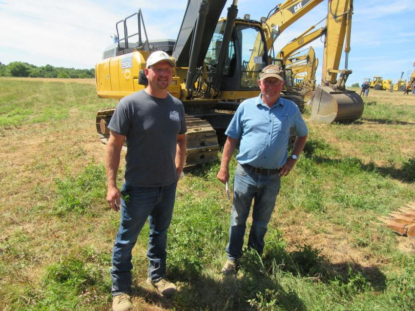 Andy (L) and Harold Spiker of Spiker Farms, came to the auction in hopes of bringing home an excavator and some trucks.