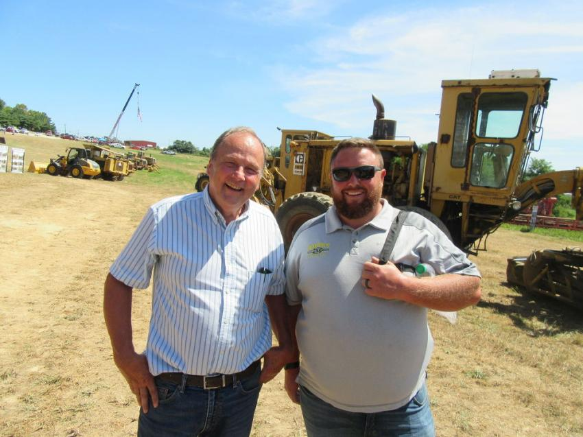 Dick Sulsberger (L) of GR Contracting Inc. catches up with Levi Baker of Baker's Welding & Crane. Baker purchased a Manitex 30100C crane at the auction.