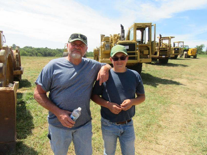 Rocky Enterprises' Tim Hall (L) with his son, Carlos, purchased a fuel tank at the Yoder & Frey sale.